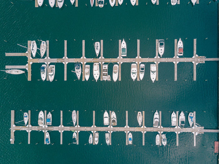 Aerial view of boats moored at harbor on sea