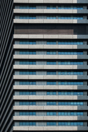 The Rebel Guy's Hospital Individuality Pattern Pieces Architecture Backgrounds Building Building Exterior Building Feature Built Structure City Day Full Frame Glass - Material In A Row Low Angle View Modern No People Odd One Out Outdoors Pattern Rebel Repetition Residential District Skyscraper Window