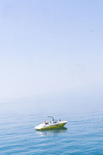 Beauty In Nature Blue Sky Horizon Over Water Jet Boat Lago Di Garda Lake View Mode Of Transport Motorboat Nature Nautical Vessel Outdoors Real People Sea Sky Transportation Water
