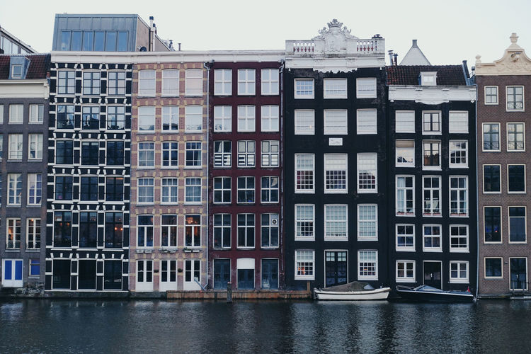 Building City Cityscape Window Architecture Water Waterfront Outdoors Side By Side In A Row Apartment Row House House Built Structure Building Exterior Residential District No People Day Travel Destinations Europe Boat Reflection Rainy Days Colorful Horizontal