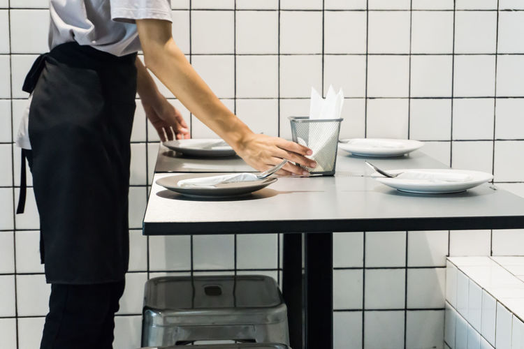 Midsection of waiter working at restaurant