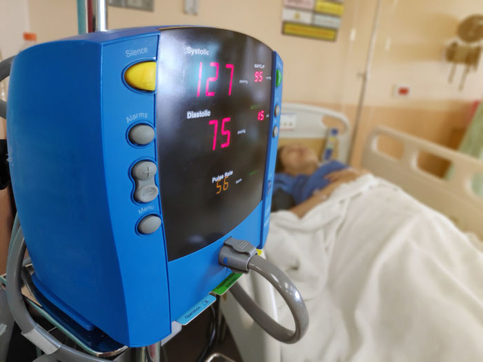 Health care for automatic digital blood pressure in hospital. Healthcare And Medicine Hospital Blue Indoors  Real People Technology Illuminated Medical Equipment Focus On Foreground Close-up Men People Patient Bed Communication Standing Control Security Safety Push Button