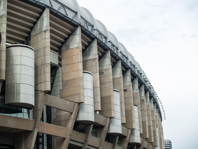Architecture EyeEm Best Shots EyeEmNewHere Football Geometric Architecture Santiago Bernabéu Stadium Sport In The City Stadium Teamwork Urban Lifestyle Architectural Column Architectural Feature Architecture Building Building Exterior Built Structure Business City Cloud - Sky Day Factory First Eyeem Photo Geometric Abstraction In A Row Industry Lifestyles Low Angle View Modern Nature No People Outdoors Pattern Santiago Bernabeu Silo Sky Sport Sport Building Still Life Storage Team Team Sport