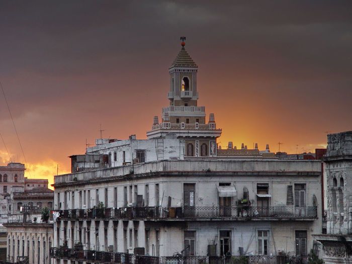Architecture Barcadi Building Building Exterior Built Structure Capital Cities  City City Life Clock Tower Cloud Cloud - Sky Cloudy Elevated View Exterior Façade No People Orange Color Outdoors Sky Sunset Tourism Travel Destinations