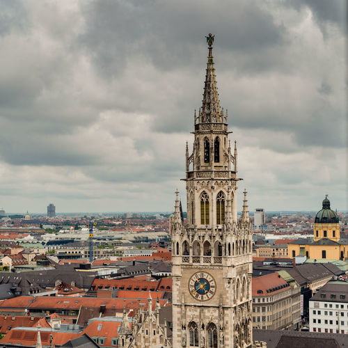 Munich, Bavaria, Germany - May 29, 2019. General aerial view of Munich from a tower, featuring a tower of the The New Town Hall (Neues Rathaus) New Town Hall Aerial Architecture Bavaria Bavarian BLUE BLUE Building Buildings Cathedral Center Church City Cityscape Cloudy Day Europe European  German Germany Historic Historical Landmark Landscape Marienplatz München Munich Nobody Roof Scenic Sky Summer Tourism Tower Town Travel View Rathaus Glockenspiel Labeled Editorial  Downtown Ancient Spring Building Exterior Built Structure Travel Destinations No People Gothic Style