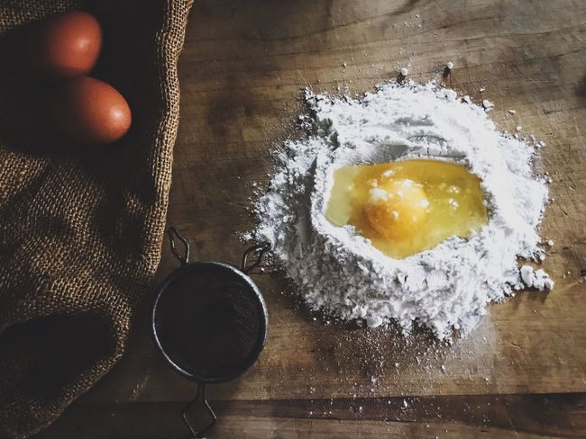 Egg in flour, sifter and farm fresh eggs on wooden surface Flour Food And Drink Indoors  Preparation  Dough Food Making Freshness High Angle View Table Raw Food Ingredient Bowl No People Close-up Flat Lay Eggs Raw Ingredients Raw Egg Sifter Farm Eggs Rustic Rustic Style Rustic Food Flatlay