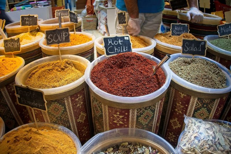 Indian spices at the market in Dubai. Choice Variation Market Food Spice Food And Drink Market Stall Retail  For Sale Freshness Business Large Group Of Objects In A Row Small Business Retail Display Abundance High Angle View Incidental People Side By Side Text Outdoors Order Sale Herb Spices Colorfull