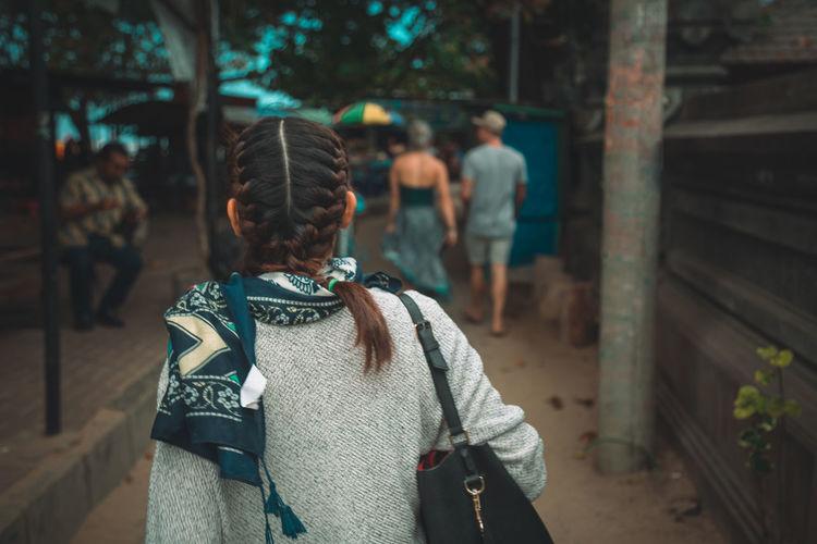 Rear view of woman walking outdoors