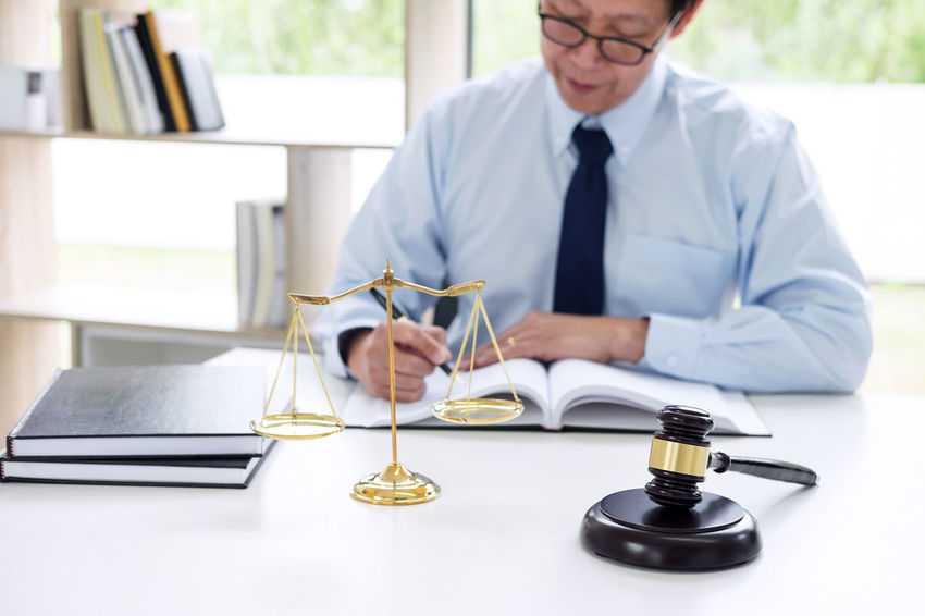 Lawyer Balance Barrister Business Business Person Businessman Connection Consultant Corporate Business Counselor Fairness Gavel Indoors  Inheritance Judge Judgement Justice Legal Legislation Men Occupation Office Shirt And Tie Sitting Verdict