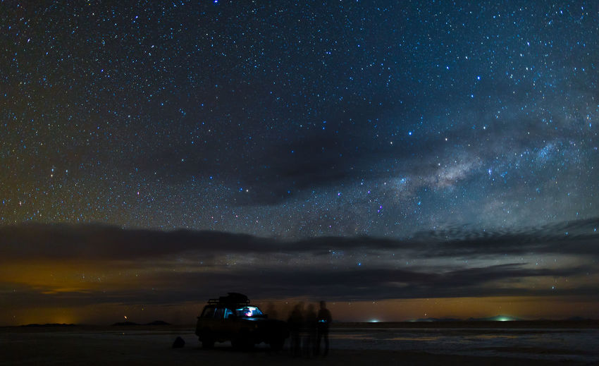 Sunset at Salar de Uyuni in Bolivia November 12, 2015. Astronomy Beauty In Nature Bolivia Cloud - Sky Dark Dramatic Sky Galaxy Illuminated Landscape Majestic Milky Way Night No People Non-urban Scene Outdoors Salar De Uyuni Scenics Sky Space Stars Tranquil Scene Tranquility Weather
