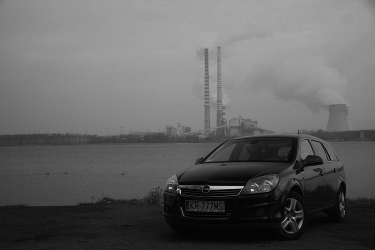 Industry Opel Air Pollution Architecture B&w Building Exterior Built Structure Car Day No People Opel Astra Outdoors Pollution Sky Smoke - Physical Structure Smoke Stack Social Issues Transportation