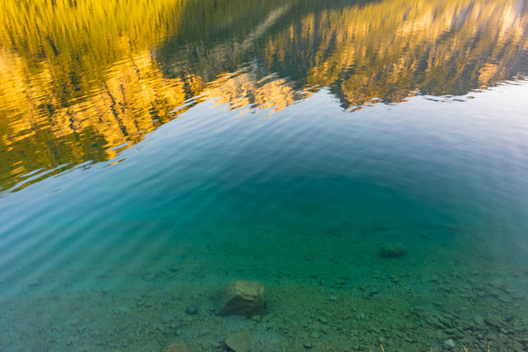 Mountain reflections in a lake Mountain Range Reflections In The Water Landscape Blue Water Sun