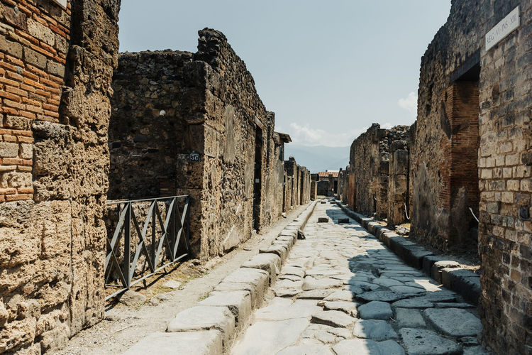Pompeii  Pompeii Ruins Italy Architecture Built Structure History The Past Ancient Wall Stone Wall Building Exterior Direction Ancient Civilization The Way Forward Old Ruin Old Travel Destinations Wall - Building Feature No People Weathered Ruined Outdoors Archaeology Diminishing Perspective Ancient History