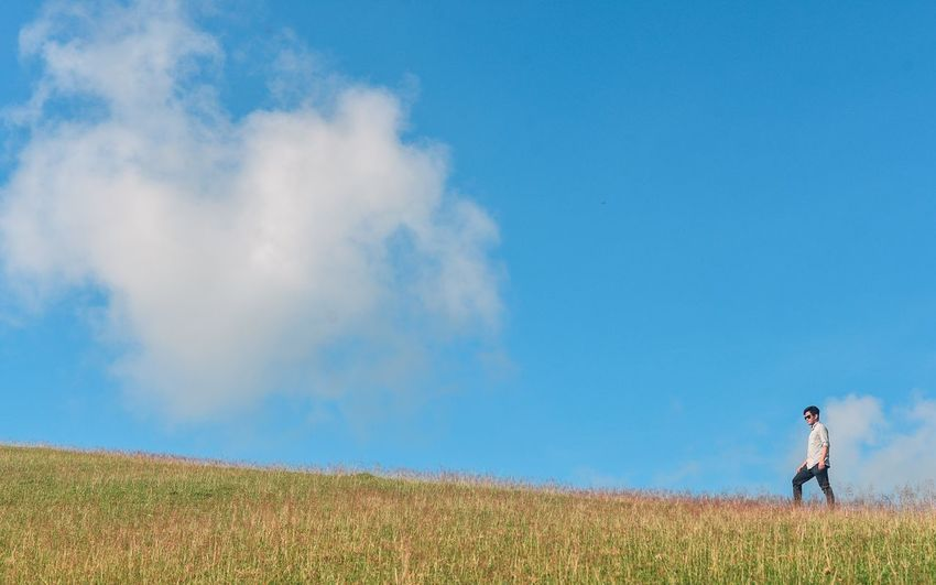 Sky Cloud - Sky Land One Person Landscape Field Beauty In Nature Nature Plant Environment Men Blue Tranquility Rural Scene Child Day Childhood Lifestyles Real People Outdoors