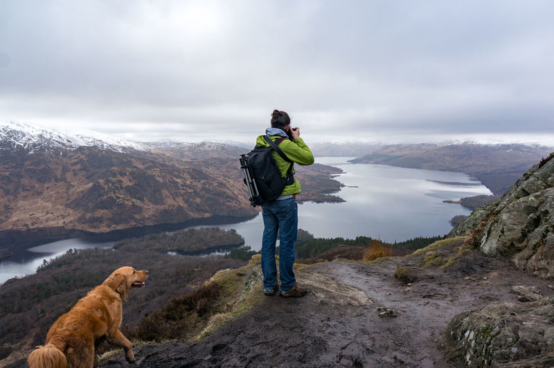 Photographing Loch Katrine Ben A'an Loch Katrine, Stirling, Scotland, UK, Random Dog Scotland Taking Photos Taking Photos Of People Taking Photos Act Of Photographing Equipment Human Landscape Loch Lomond March Mountain Range One Person Photographing Reflections Self Portrait Summit Go Higher