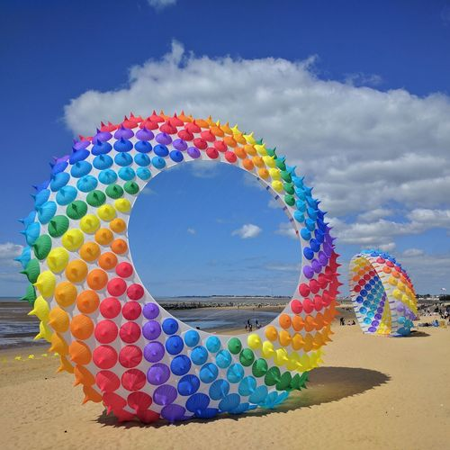 Multi Colored Rainbow🌈 Blue Sky Sunnyday Amazing Kite Outdoors Photograpghy  Outdoors Beach Time Beach Photography Sea Followme Competition Event