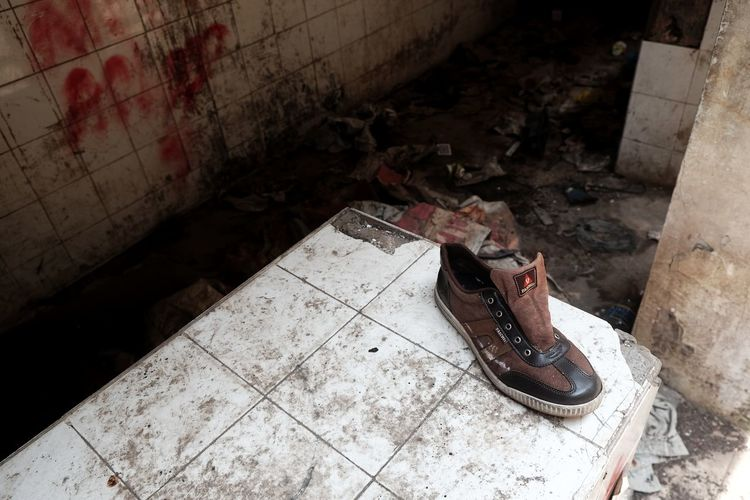 High angle view of shoes on floor in abandoned building