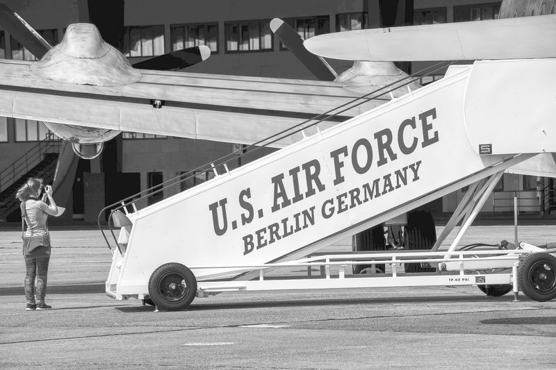 Berlin Berlin Photography Tempelhof U.S. Air Force Airplane Airport Black And White Blackandwhite Day Mode Of Transport One Person Outdoors People Real People Tempelhof Airport Text Transportation Women Stories From The City