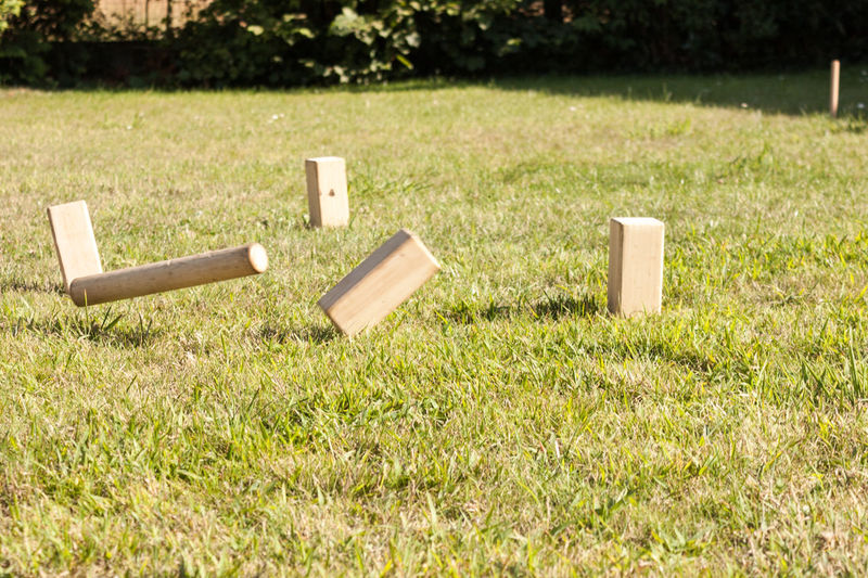 Block Day Falling Fun Game Grass Green Color Knocked Over Kubb No People Outdoors Playing Stick Thrown Wooden