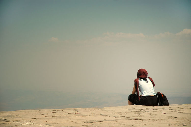 Woman relaxing on the top of mountain Nemrut Sky And Clouds Trekking Woman Cheerful Idyllic Leisure Activity Lifestyles Nature Nemrutdağı One Person Outdoors People Real People Rear View Relaxation Scarf Scenics Sitting Sitting On The Top Of The Mountain Sky Summit Top Of Mountains Wondering Young Adult