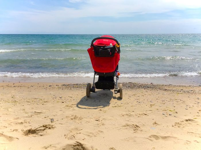 Beach Beauty In Nature Children Cloud Cloud - Sky Coastline Getting Away From It All Horizon Over Water Nature Non-urban Scene Outdoors Red Sand Scenics Sea Shore Sky Stroller Summer Tourism Tranquil Scene Tranquility Vacations Water Wave