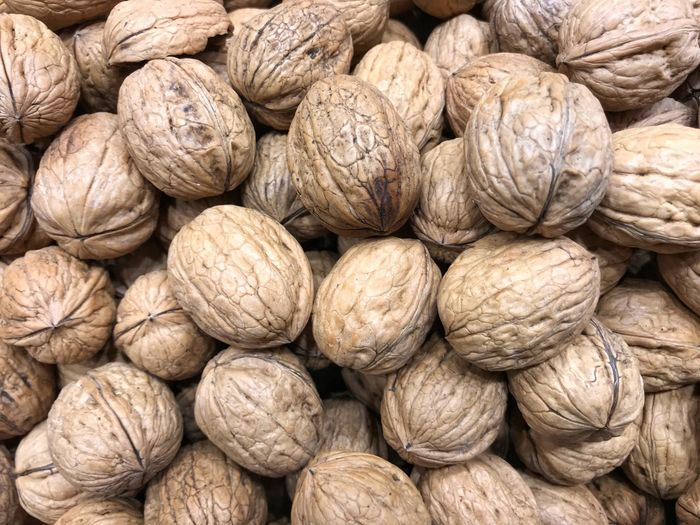 Full frame shot of whole walnuts