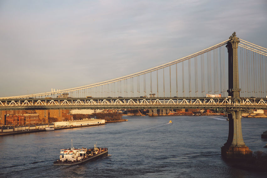 Architecture Bridge - Man Made Structure Built Structure Business Finance And Industry City City Connection Day Manhattan Manhattan Bridge Nautical Vessel New York New York City No People Outdoors River Sky Sunset Suspension Bridge Transportation Travel Travel Destinations Water Winter