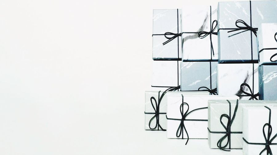 Many white and gray gift boxes with white background. Presents Gift Box No People Copy Space Art And Craft Creativity Wall - Building Feature Indoors  Built Structure White Color Studio Shot Arrangement Large Group Of Objects