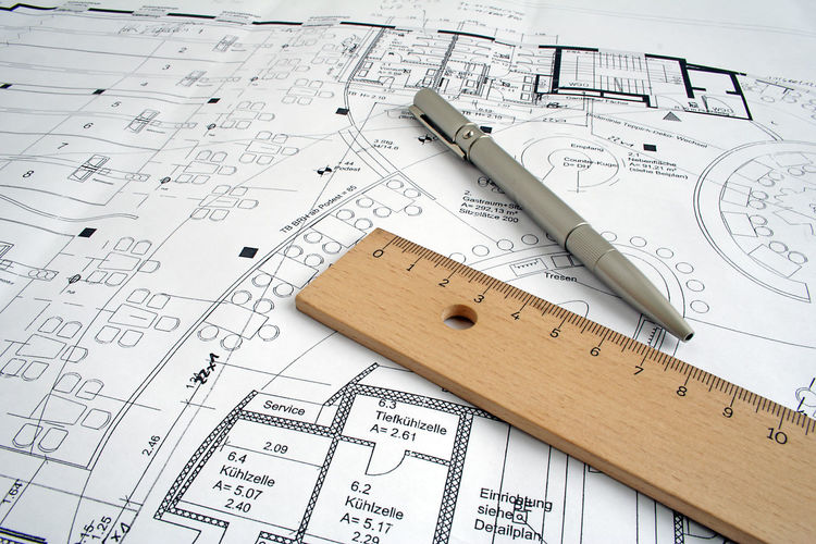 Close-up of pen and ruler on blueprint