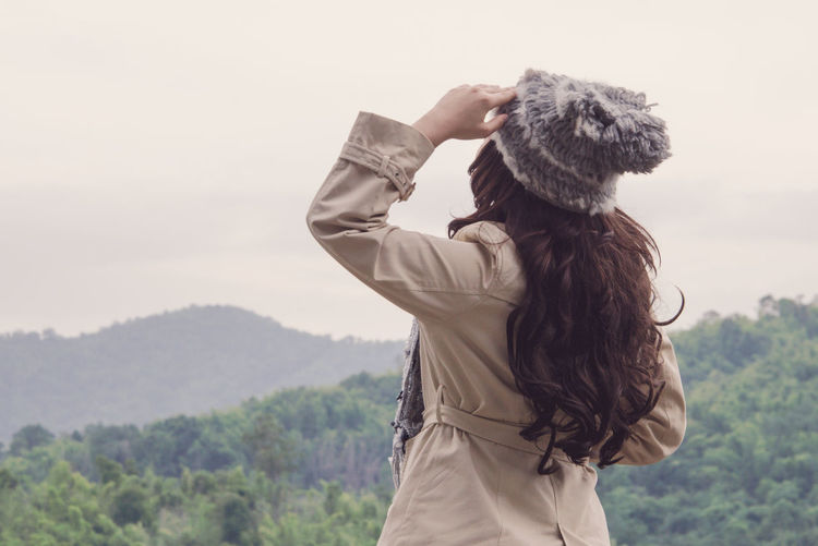 relax Arms Raised Beauty In Nature Lifestyles Long Hair Looking At View Mountain Nature Non-urban Scene One Person Rear View Relax Sky Standing Tree Women