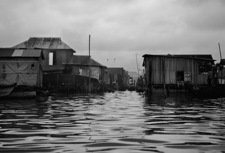 💦 Thewaysofseeing Blackandwhite Streetphotography Water Building Exterior Sky Cloud - Sky Built Structure Architecture Building Rippled No People Nature Sea Transportation Day House Outdoors Residential District Pollution Waterfront Floating On Water