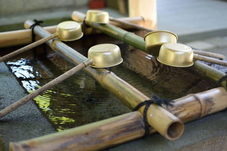 Bamboo dippers over water