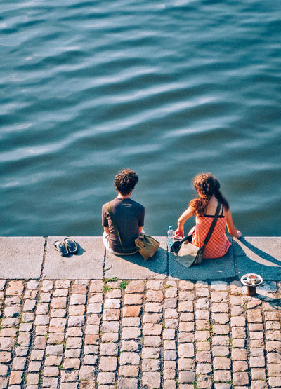 Couple Czech Republic Lovers Prague River Sitting Students Togetherness Tranquility Travel Vltava Water