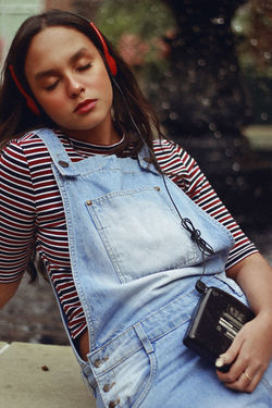 i'm yr baby, 2018 90s Music Poetic Retro Romantic Sitting Adult Casual Clothing Contemplation Day Focus On Foreground Front View Holding Jeans Leisure Activity Lifestyles Looking One Person Outdoors Real People Striped Waist Up Women Young Adult Young Women