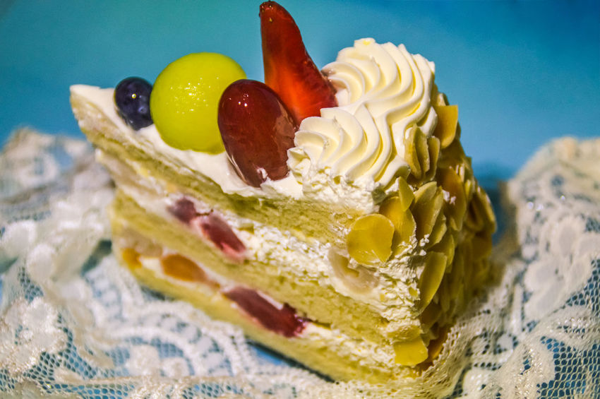 Slice of Christmas fruity cake Fruit Cake  Slice Of Cake Christmas Cake Seasonal Food Blue Copy Space Lace Foodie Pastel Colors Sweet Food Food And Drink Dessert Indulgence Cake Food Close-up Indoors  Temptation Birthday Freshness No People Ready-to-eat