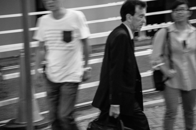 Hong Kong Streets Hong Kong Hong Kong City Adult Architecture Blurred Motion Casual Clothing City Day Defocused Group Group Of People Incidental People Lifestyles Men Motion on the move People Real People Speed Sport Streetphotography Transportation Walking