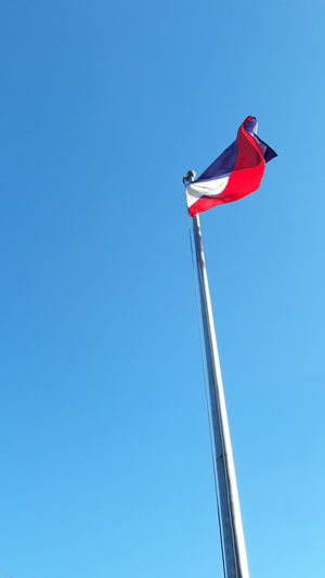 Colors of blue, red, white and yellow with a sun and 3 stars combined well that shows the nationality of Filipino. Blue Yellow Sun Stars Sky Flag Pole Flag In The Wind Flag Filipino Filipino Pride✌ Filipinoculture Filipino Culture Philippines Philippinesphotography Philippines. Flag Red Patriotism Low Angle View Blue Wind Sunny Day Clear Sky No People Sky Motion Flying Outdoors
