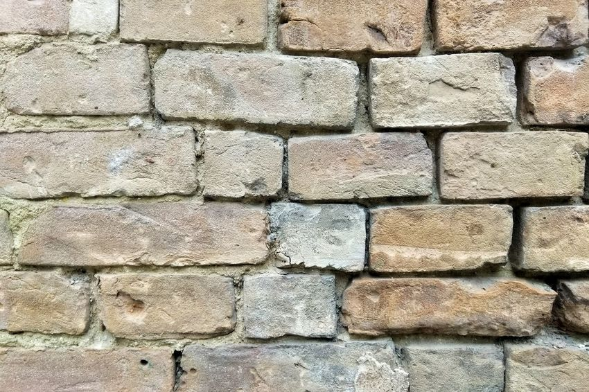 Wall of bricks Backgrounds Full Frame Stone Tile Textured  Close-up Architecture Stone Wall Brick Wall Brick Wall Pattern Wall - Building Feature Stone Material
