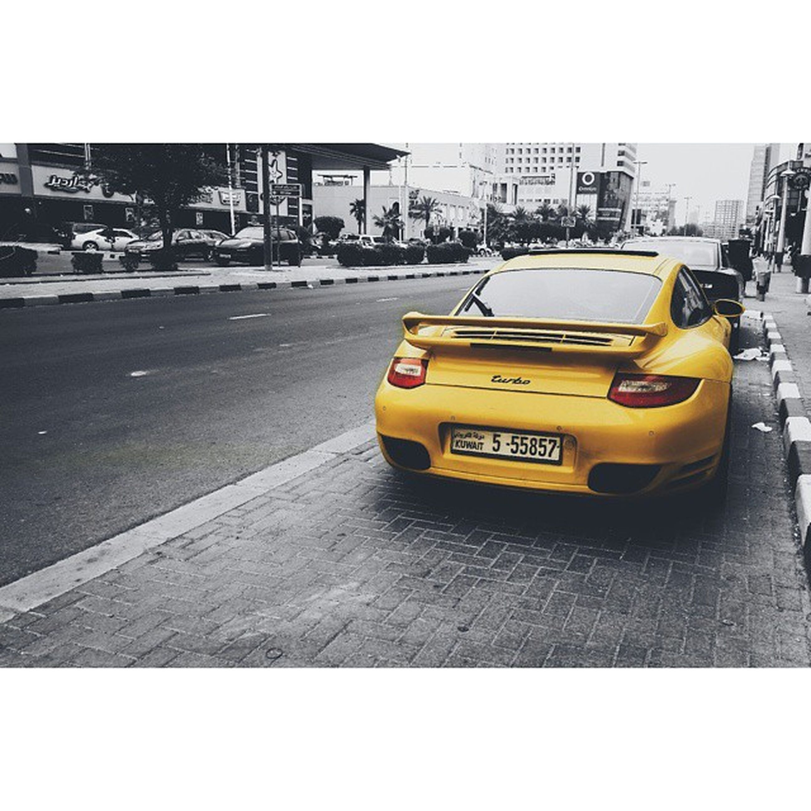 transportation, mode of transport, car, land vehicle, transfer print, city, street, yellow, building exterior, architecture, auto post production filter, traffic, road, built structure, city life, text, city street, travel, public transportation, road marking