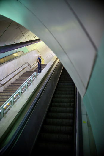 The Architect - 2019 EyeEm Awards EyeEm Best Shots Eye4photography  Getting Inspired My Best Photo Underground Notes From The Underground The Portraitist - 2019 EyeEm Awards Real People Indoors  One Person Portrait Architecture Staircase Steps And Staircases Transportation Escalator Built Structure Low Angle View Moving Up The Way Forward on the move Direction Men Lifestyles Modern Moving Walkway  Ceiling