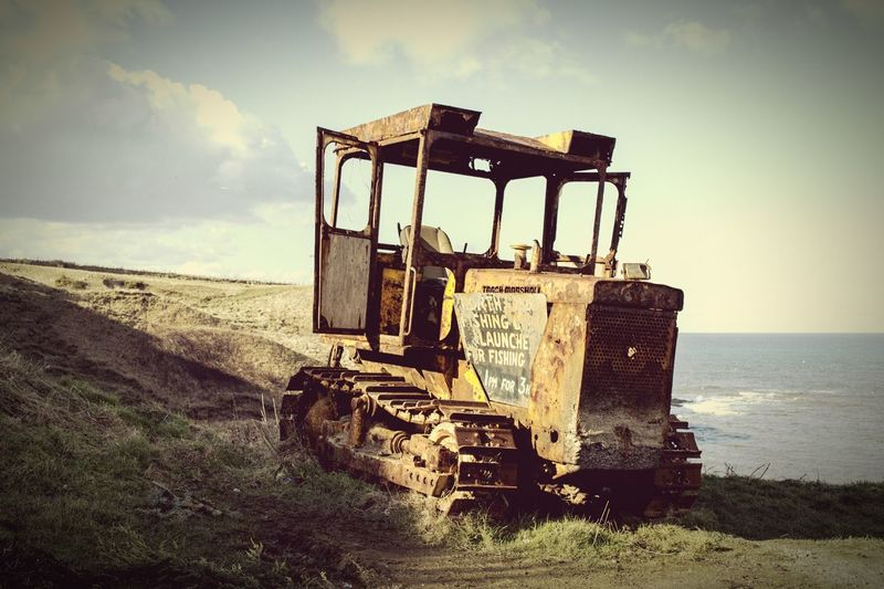 Beauty In Nature Tranquility Sky Tractor Deterioration Old Abandoned Sea View Clouds Cloud - Sky Day Remote Run-down Scenics Shore Tranquil Scene Water Flamborough Head Rusty Rustic Horizon Over Water Obsolete
