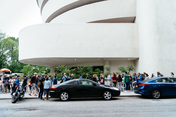 Solomon R. Guggenheim Museum in New York Architecture Day Manhattan NYC NYC Street Photography America American Architecture Solomon R. Guggenheim Museum Museum Frank Lloyd Wright Frank Lloyd Wright Architecture Guggenheim Guggenheimmuseum Guggenheim Nyc Travel Travel Destinations Tourism Tourist Attraction  Group Of People Transportation Crowd Mode Of Transportation Car Large Group Of People Men Motor Vehicle Real People Women Land Vehicle City Adult Road Street Leisure Activity Lifestyles Outdoors Spectator