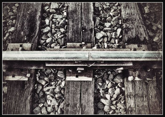 Rails Rail Road Outdoors Day Nature Forestry Industry No People Monochromatic Frame Rock Focus Metal Industrial Photography Close-up Micro Nature Micro Close Up Wood - Material