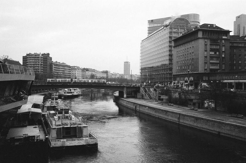 The Danube Chanel - Vienna / Austria. Unedited Analogue Photography Blackandwhite Leica M6 Kodak Tri-X 400 - Building Exterior Architecture River Canal Skyline Bridge Tram Minimalist Architecture