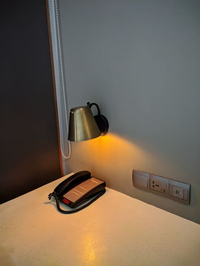 High angle view of electric lamp on table at home