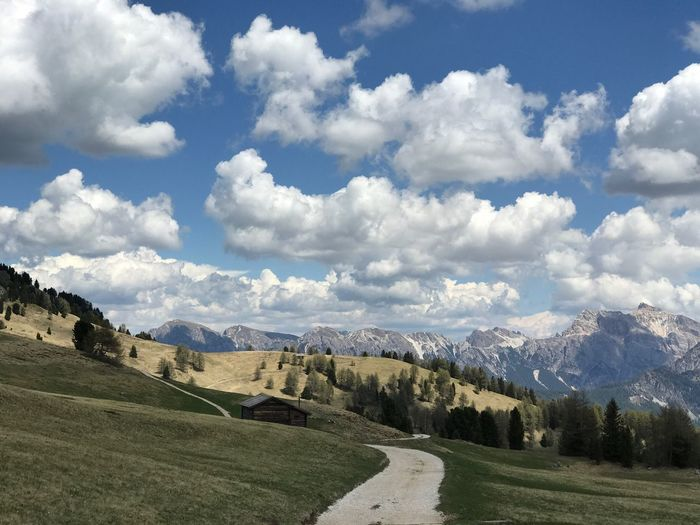 Nature Sky Mountain Landscape Scenics Tranquility Tranquil Scene Cloud - Sky Beauty In Nature Day No People Mountain Range Outdoors Grass Tree South Tyrol