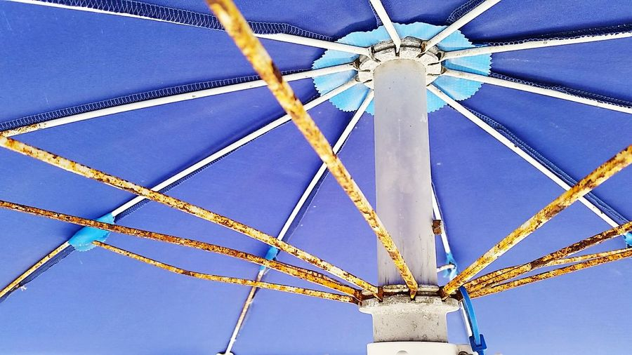Low Angle View A Bird's Eye View Colorful Blue Day Vibrant Colors Rust Umbrella Decay