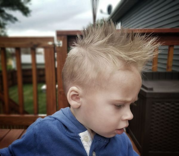 Close-up of cute boy with spiky hair