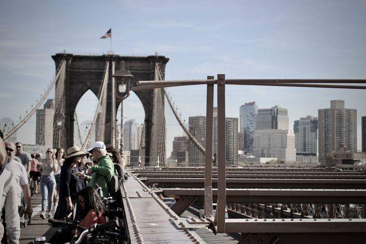 People at brooklyn bridge in city