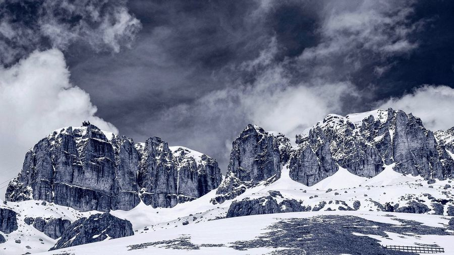 Dolomites, Italy Italy Mountains Cloud - Sky Sky Nature Low Angle View Beauty In Nature No People Day Outdoors Plant Tree Non-urban Scene Snow Scenics - Nature Tranquility Motion Environment Growth Land Silhouette Power In Nature